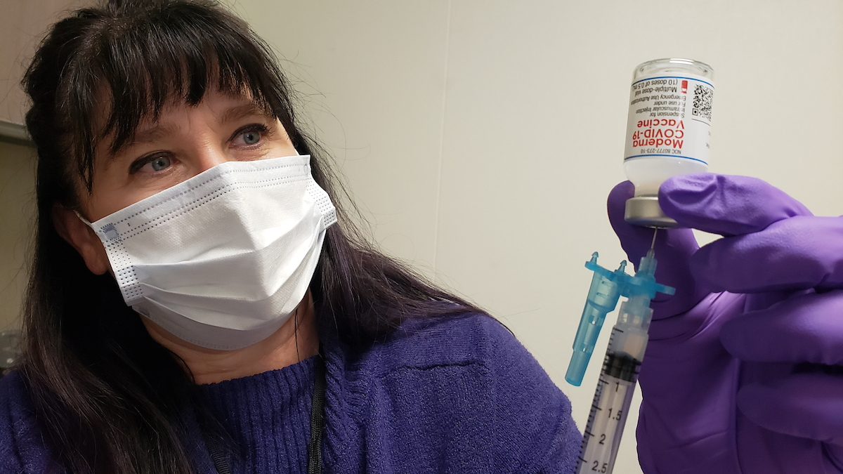 Lisa McAllister prepares a syringe
